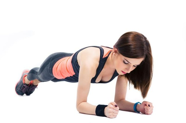 Planks on the Power Plate can be intensified by lifting one leg at a time.