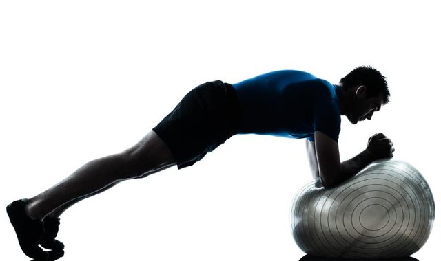 Adding an exercise ball is a great way to make a plank more challenging.