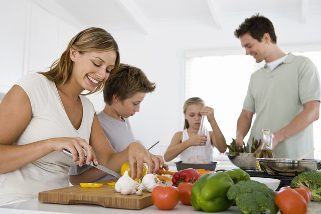 A family prepares a well balanced meal.