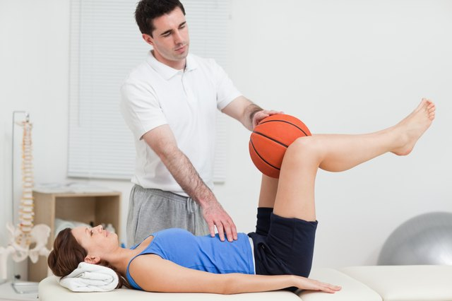 Doctor helping with excercise