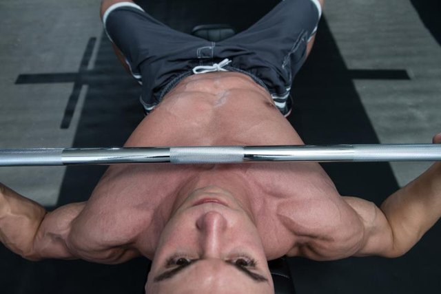 The best bench press programs involve either heavy weight or high reps.