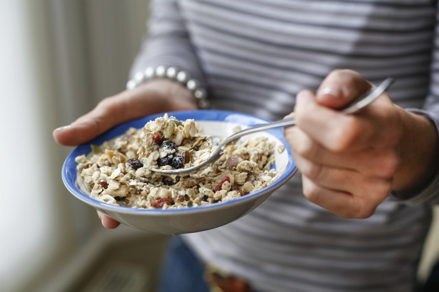 woman holding bowl of healthy granola cereal
