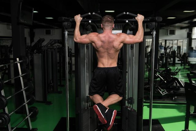 An assisted pull-up machine helps you build the strength for a full push-up.
