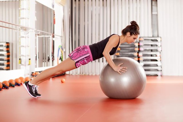 A stability ball push-up increases core activation.