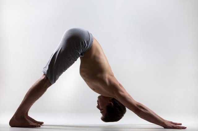Engage your pelvic floor while holding Downward Dog.
