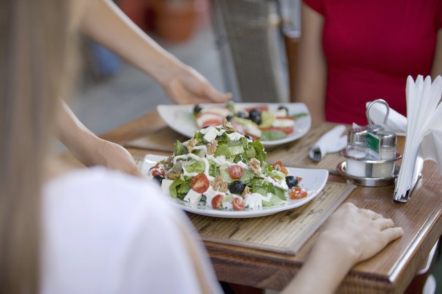 Salad being served at restaurant