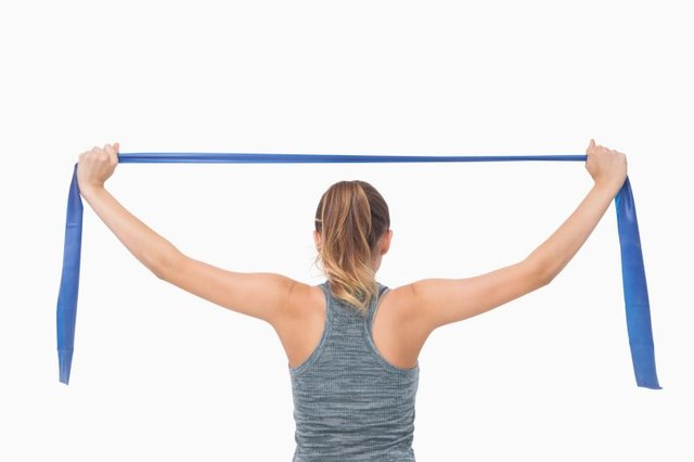 A resistance band offers a weight-free way to work your back.