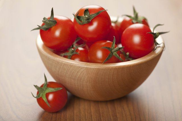 Small wooden bowl of cherry tomatoes
