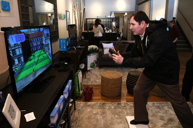 A man scores points in a Wii Fit game during a demo.