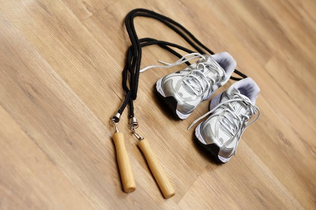 Running shoes and a jump rope on the floor of a work-out studio.