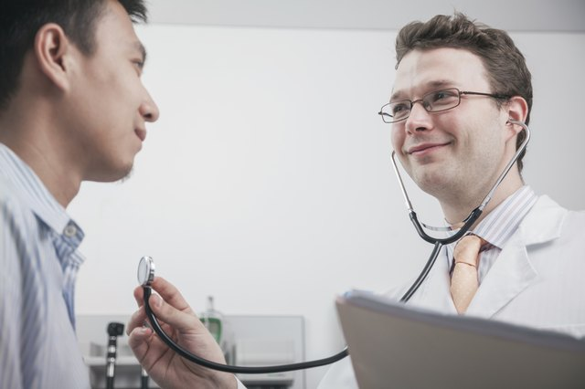 Doctor checking patient with a stethoscope