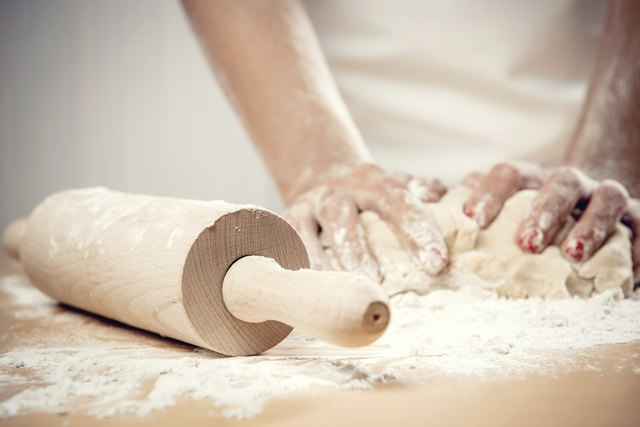 Man baking with white flour