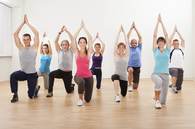 large group of people in yoga class
