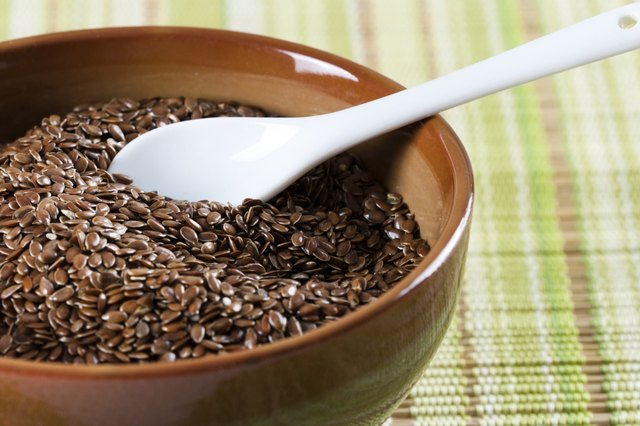 Brown flaxseeds in bowl with spoon