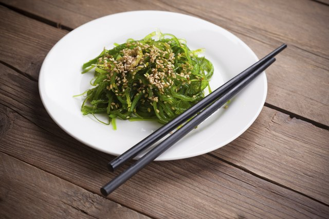 Wakame salad with chopsticks