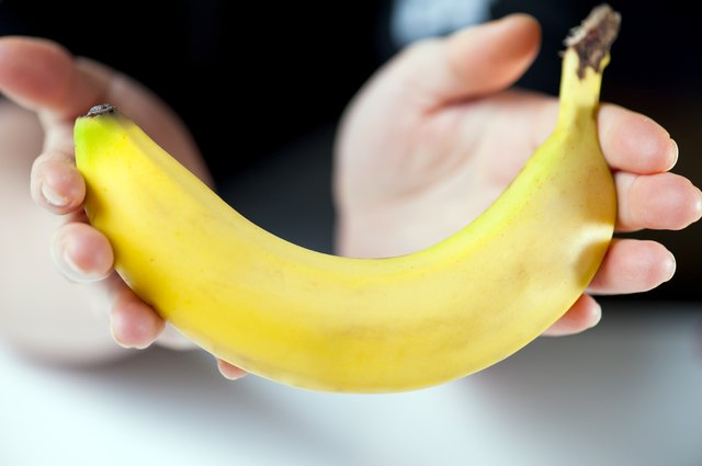 hands holding banana