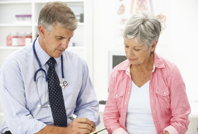 Woman with doctor discussing menopause.
