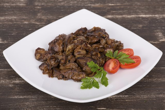 Chicken livers on a plate with garnishes
