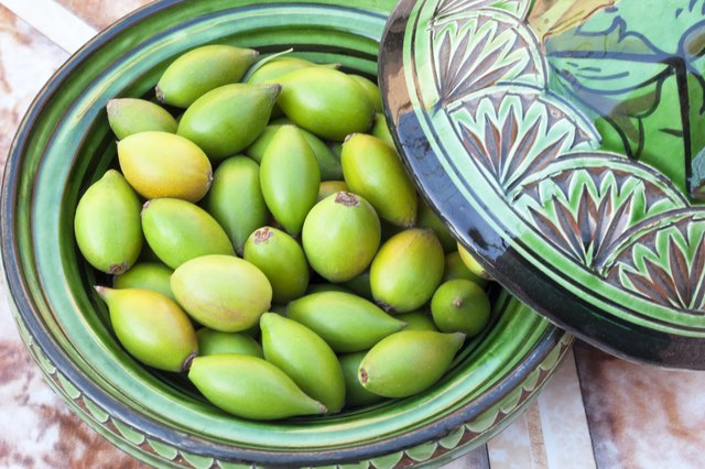 A bowl of green argan nuts in a Moroccan bowl.