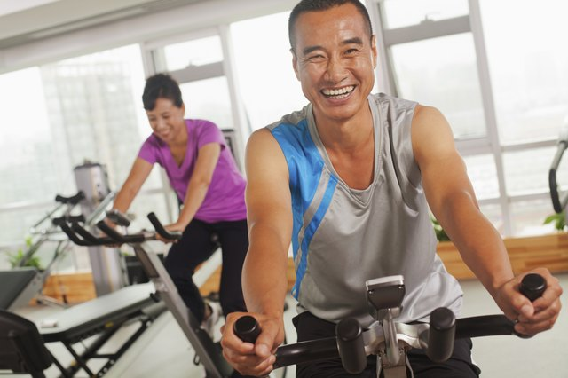 Man smiling on stationary at gym