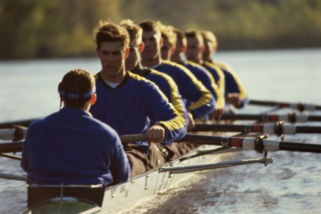 A rowing team trains on a river.