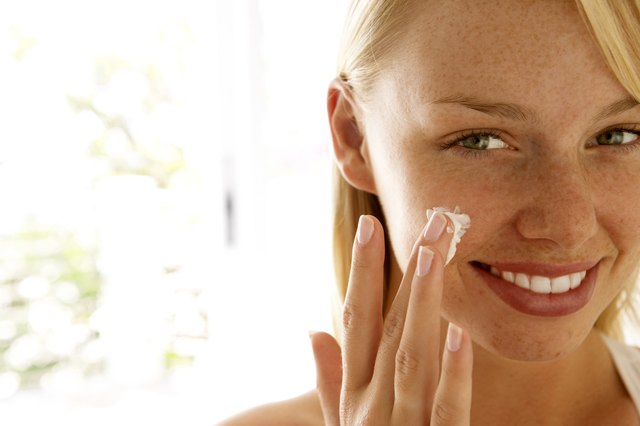 Moisturize your skin with a product that is not oil based.