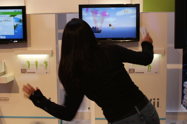 Woman trying game out on Wii Fit Plus