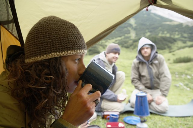 Woman drinking tea in tent