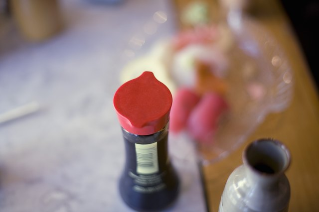 A bottle of soy sauce on a table.
