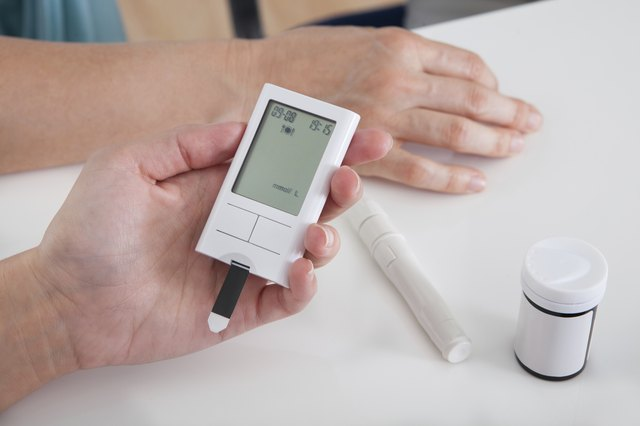 woman holding blood-glucose level tester