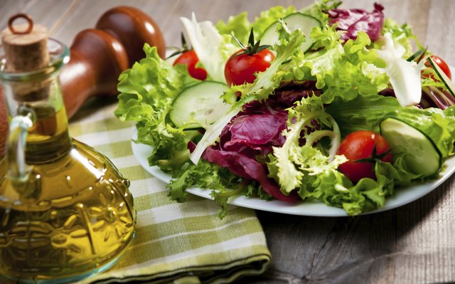 olive oil beside a salad
