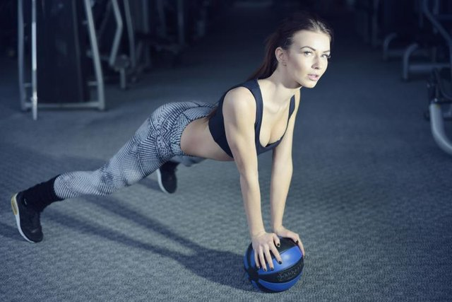 A medicine ball offers variety on the push-up.
