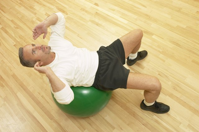 Perform crunches on a stability ball.