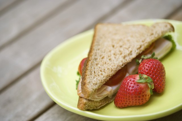 Turkey sandwich with fruit.