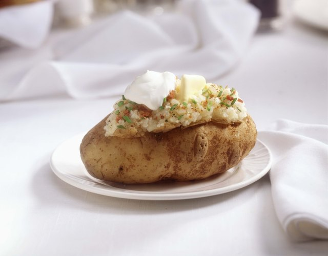 Try topping a baked potato with chili or sour cream and chives for a quick and nutritious lunch.
