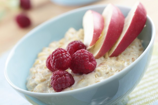 bowl of plain oatmeal with fruit in it