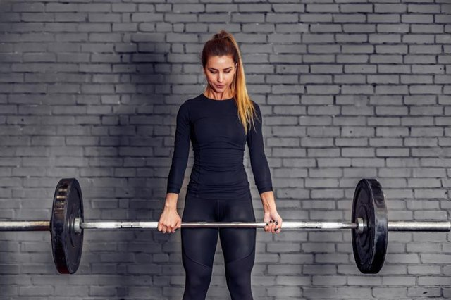 Fully extend your hips at the top of a deadlift.