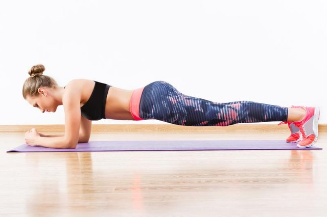 Start in a classic plank position.