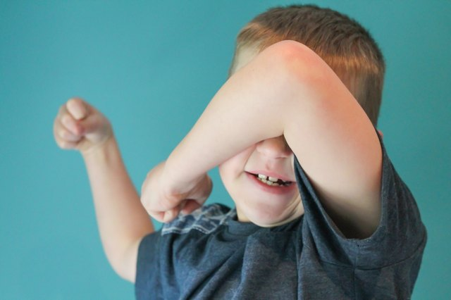 Children with autism may stimulate themselves by flapping hands in front of eyes.