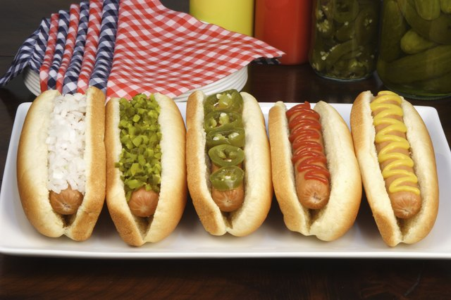 Hot dogs with assorted condiments