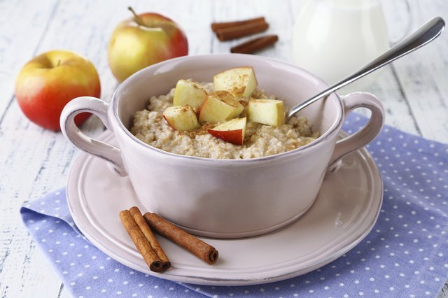 A small bowl of oatmeal with fruit.