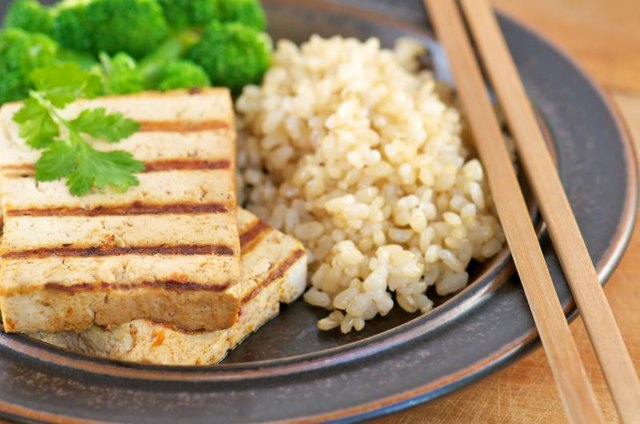 Pair pan-grilled tofu with rice and vegetables.