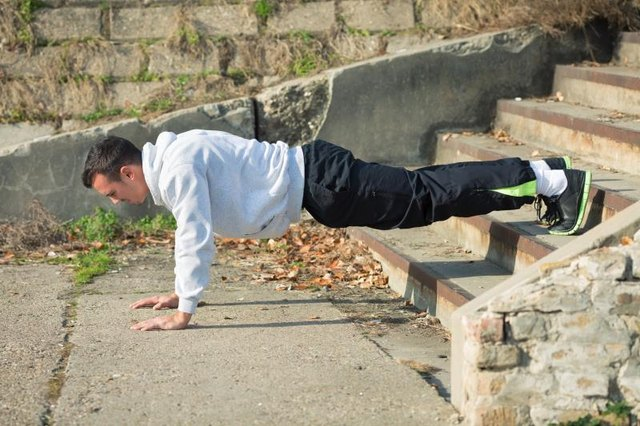 Steps, a workout bench or riser, create a decline.