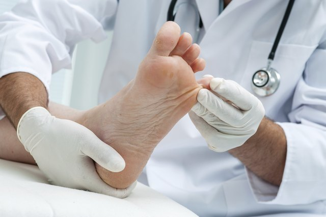 Doctor examining patient's toe