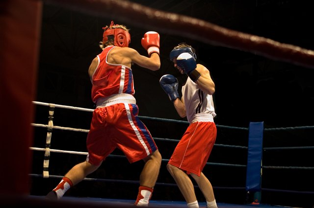 Boxers sparring in ring