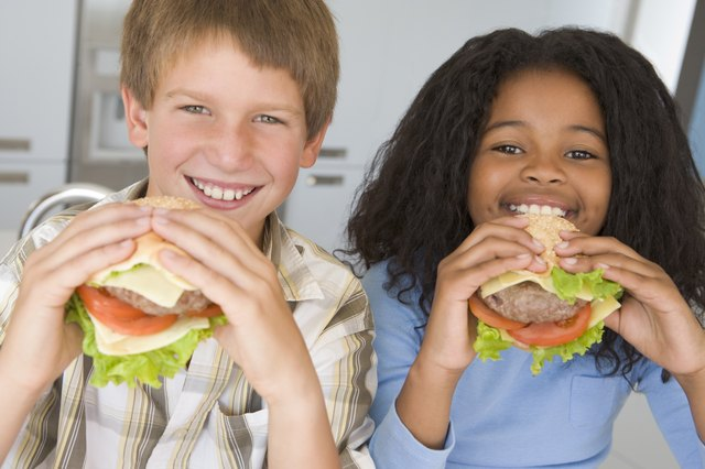 children eating lean beef cheeseburgers