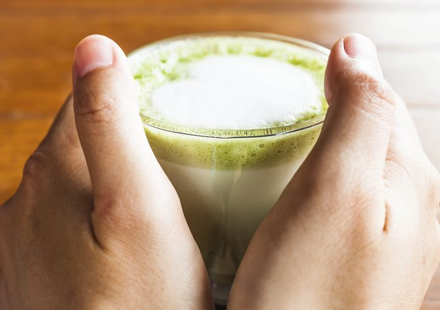Green tea and milk present in the latte offer health benefits.