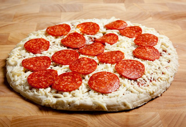 In addition to being high in calories and fat, commercial pizzas are high in sodium with 500 to 700 milligrams per slice.