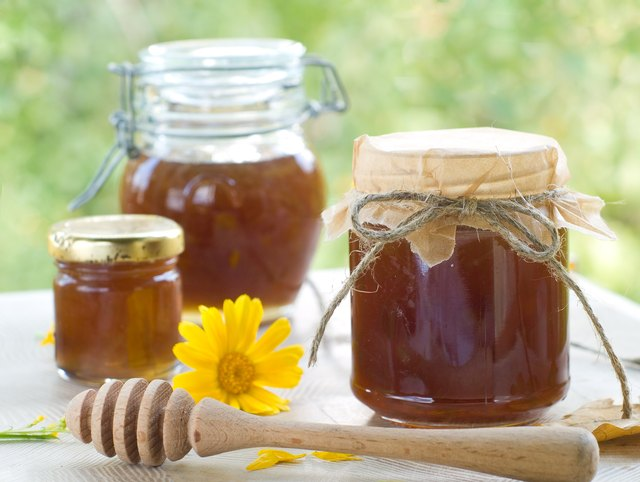 Jars of honey on an outdoor table