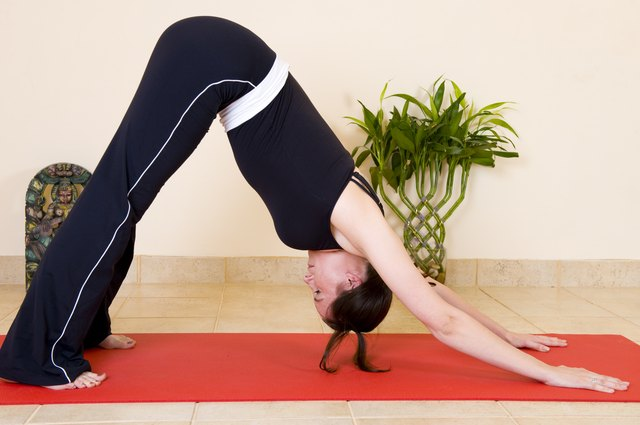 Practice yoga to develop your arm muscles.